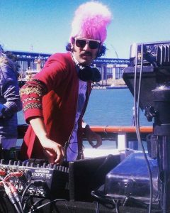 The American DJ Atish playing at a boat party