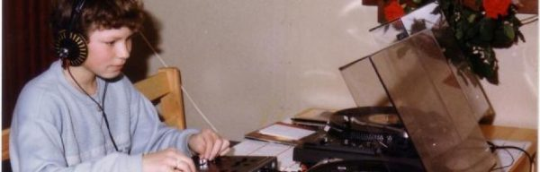 Jerome Krom as a child, practicing with two turntables
