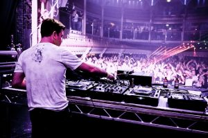 Paul Oakenfold behind the spinning wheels